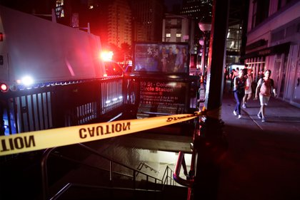 People passing a taped-off subway station during the power outage (JASON SZENES/EPA-EFE/Shutterstock)