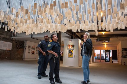 Two NYPD officers visited the Museum of Broken Windows on Sunday. Daveen Trentman of the Soze Agency, which helped the NYCLU curate the pop-up, gave them a tour.</br>