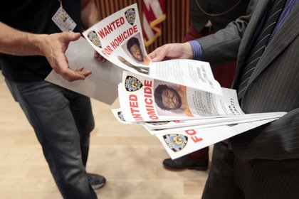Police distributed Wanted posters after a press conference yesterday