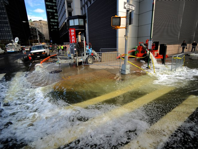 Workers pumping flood waters from a building in Lower Manhattan following Hurricane Sandy