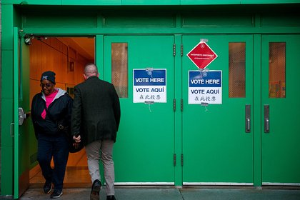 Voters leaving and entering the polling site at Public School 261 (Getty Images)
