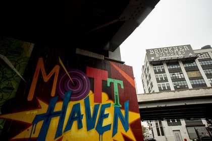 Mott Haven mural in front of the Bruckner Building, which a real estate investment firm has renovated for commercial lofts.