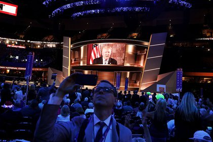 Trump addressed the convention arena remotely last night, using the giant jumbotron. (Getty)