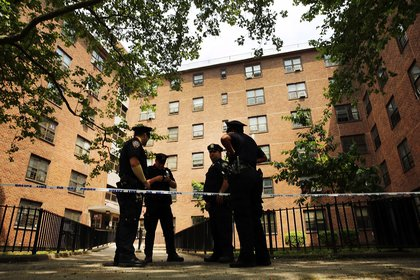 Police officers at the Boulevard Houses in East New York, where P.J. and Mikayla Capers were attacked