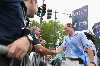 Spitzer campaigning at the West Indian American Caribbean Day Parade.<br/>