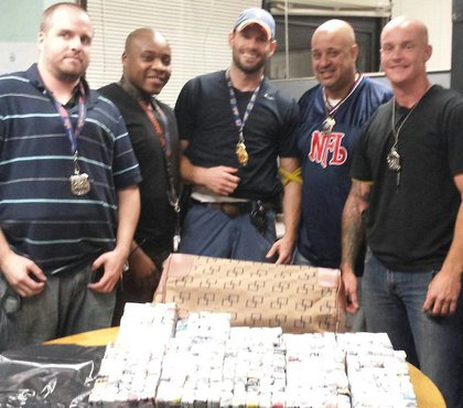 The NYPD officers involved in the seizure, from left to right: PO Stephen Schoefer, PO Cleavens Duchatelier, Sgt Brian Holshek, Det Carmelo Santana, and PO Michael Walsh