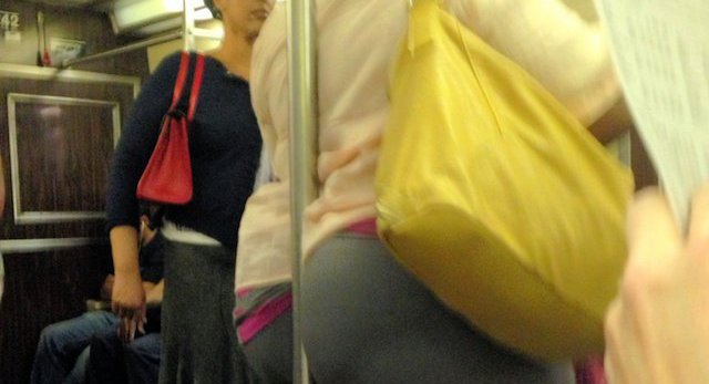 Photo: Subway Pole Disappears Into Straphanger's Posterior ...