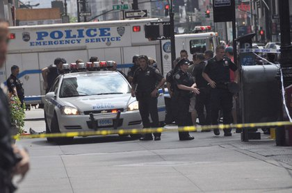Photo of the scene after the shooting—note the suspect's feet on the left