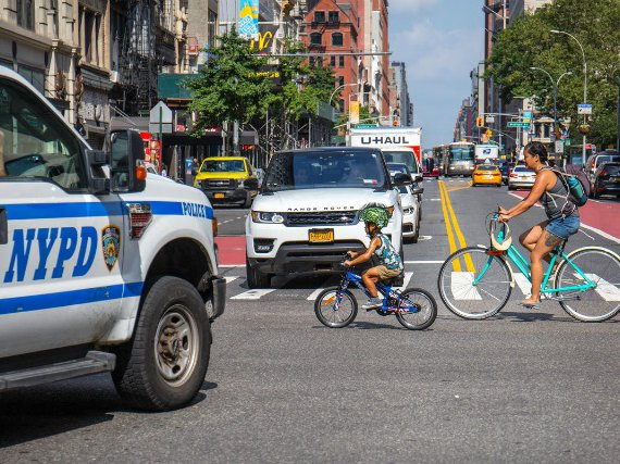 Cyclists ride during Summer Streets