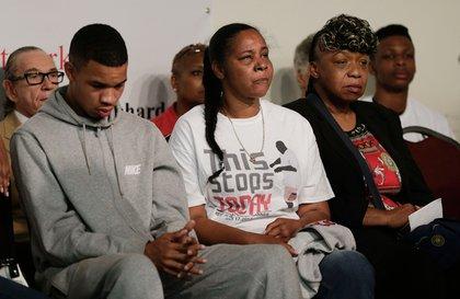 Eric Garner's son Eric Snipes; Garner's widow Esaw Garner; Garner's mother Gwen Carr