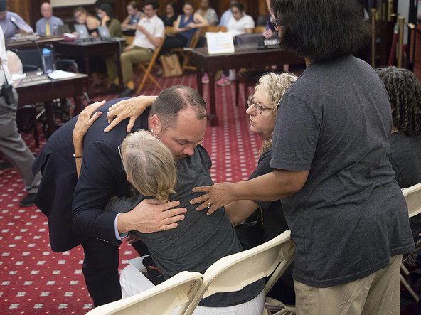 City Council Speaker Corey Johnson hugs a safe streets advocate on Tuesday during an emergency Transportation Committee hearing on speed cameras.