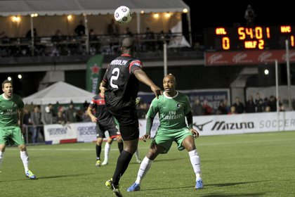 Marcos Senna faces Silverbacks defender Mike Randolph.