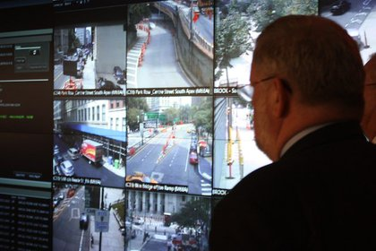 NYPD Deputy Commissioner, Public Information Paul Browne watches the screens of the Domain Awareness System in Lower Manhattan