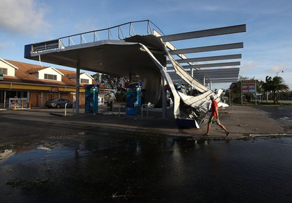 The roof of a gas station is shown damaged by Hurricane Irma winds on September 11, 2017 in Bonita Springs, Florida. (Getty)