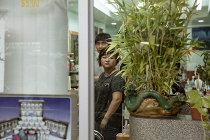 Nail salon workers watch the protesters.<br>