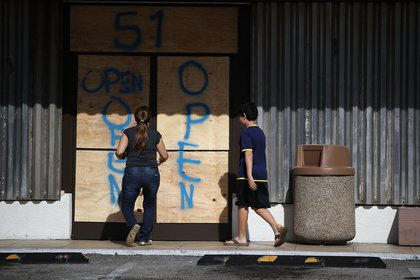 A business is prepared for Hurricane Irma with boarded up windows and doors on September 7, 2017 in Key Biscayne, Florida. (Photo by Joe Raedle/Getty Images)