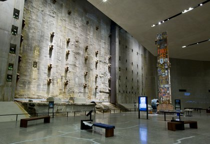 """The """"Last Column"""" was the last one removed from the WTC site on May 30, 2002. It's 58 tons and 36 feet tall and bears the signatures of and photographs from recovery workers, first responders, volunteers and victims' relatives.<br/>"""