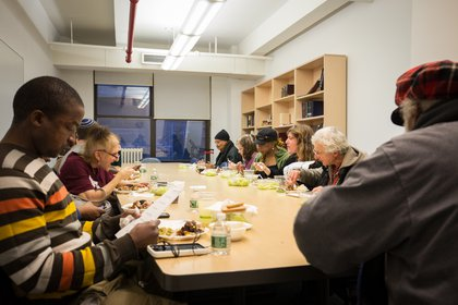 Individuals who have experienced homelessness shared a meal with advocates, family, and friends before the memorial.<br/>