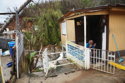A man sits nearly three weeks after Hurricane Maria hit the island, on October 10, 2017 in Utuado, Puerto Rico. Most of the municipality is without running water or grid power. <br/>