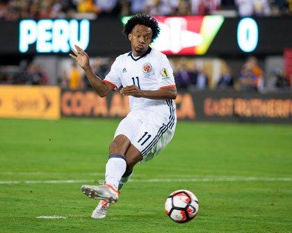 Colombia's Juan Cuadrado scores during the penalty-kick shootout.