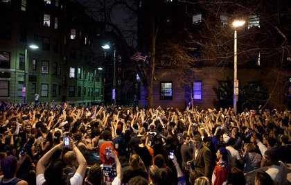 An estimated 200 people pour onto Hemingway Street in the Fenway neighborhood last night in Boston