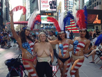 Claire Hogenauer, a former lawyer, was topless in solidarity<br/>