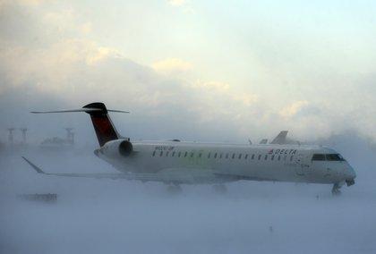 A plane struggles through the snow (AP)