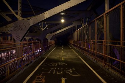 On the Williamsburg Bridge the light stops... right there. (Reuben Hernandez)