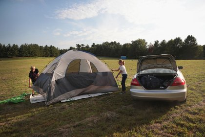 Karen Just and her son Mathew pitch a tent in a hay field which had been converted into a campground to host visitors for Monday's solar elclipse on August 18, 2017 near Carbondale, Illinois. With approximately 2 minutes 40 seconds of totality the area in Southern Illinois will experience the longest duration of totality during the eclipse. <br>