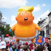 Thousands of protesters march alongside the 'Trump baby' balloon in central London during President Trump's visit to the U.K. on July 13, 2018. (Rob Pinney/LNP/Shutterstock)