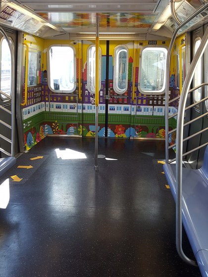 Seats were taken out at the end of the subway cars for more standing room. <br>