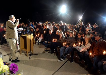 Rev. Kent McHeard speaks to family members and friends during a candlelight vigil memorial at Mohawk Valley Gateway Overlook Pedestrian Bridge in Amsterdam, N.Y.<br>
