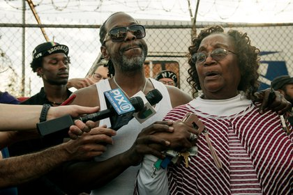 Ernest brother's Melvin Askew Jr., and his aunt, Joyce Cannady, speak to reporters. <br/>