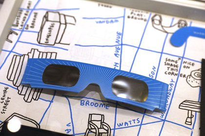 A pair of free solar eclipse glasses sit on display at a Warby Parker store on August 11, 2017 in New York City. <br>