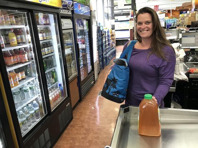 A supermarket shopper in Long Beach with a reusable bag.