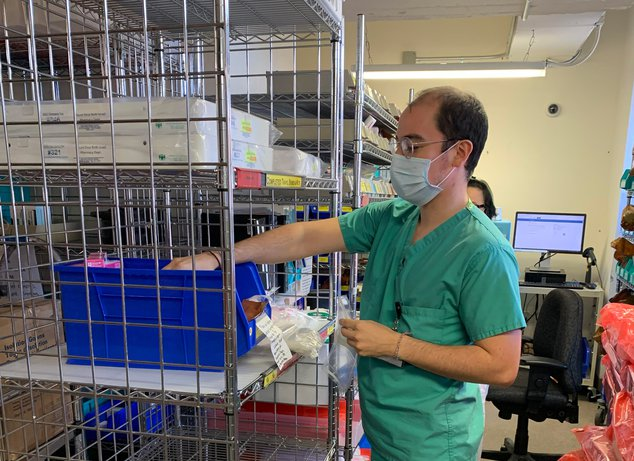 Cesar Andrade, 4th year medical student; A member of the Pharmacy Task Force, Cesar is organizing meds for OR trays to ensure they remain uncontaminated.