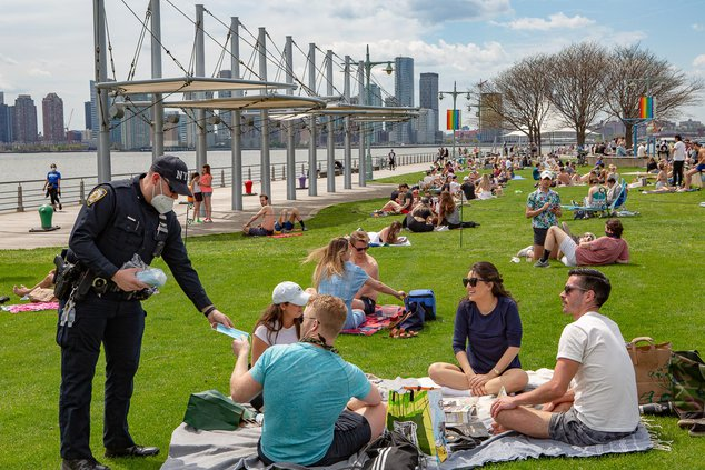 Cops handing out masks to people at Christopher Street Pier, Sunday May 3rd, 2020.