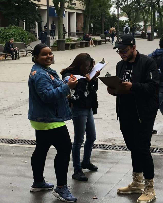 Jessica Rosario on a street, registering voters in 2018
