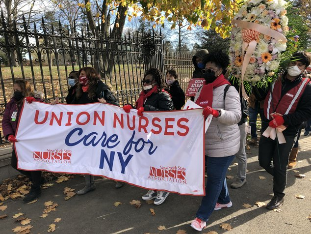 Nurses employed at Montefiore Health System in the Bronx march to Woodlawn Cemetery, protesting their demands for more nurses.