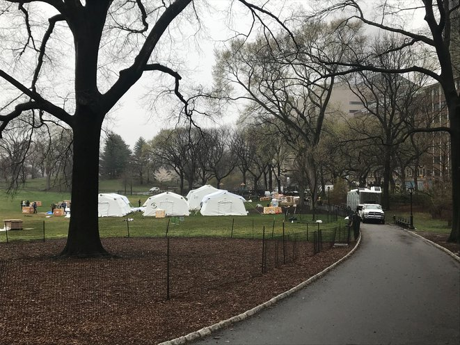Workers assemble emergency field hospital tents in Central Park during the coronavirus pandemic.