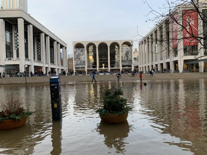 Scenes from a water main break outside Lincoln Center