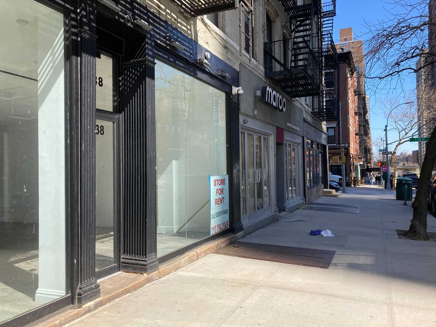Empty storefronts along Third Avenue with a