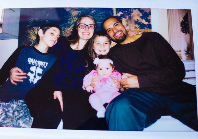 A photograph of a photograph of Jacob Rouse, his wife Samantha, and children.