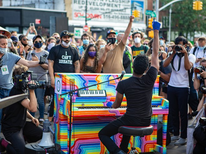 Jon Batiste performs with hundreds watching at Barclays Center
