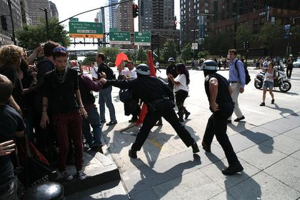 An NYPD officer pulls a protester off the pedestrian island at West Street and the West Side Highway to make an arrest