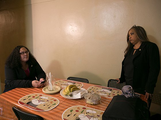 NYCHA resident Glady Sanchez, speaks with HUD's Lynne Patton in her apartment in the Patterson Houses