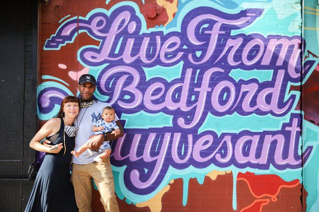 Skye Von and James Lomax in front of a mural in Bed-Stuy, Brooklyn