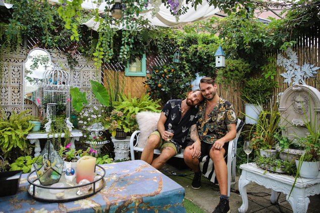 Ben and Taylor in their garden in Bed-Stuy