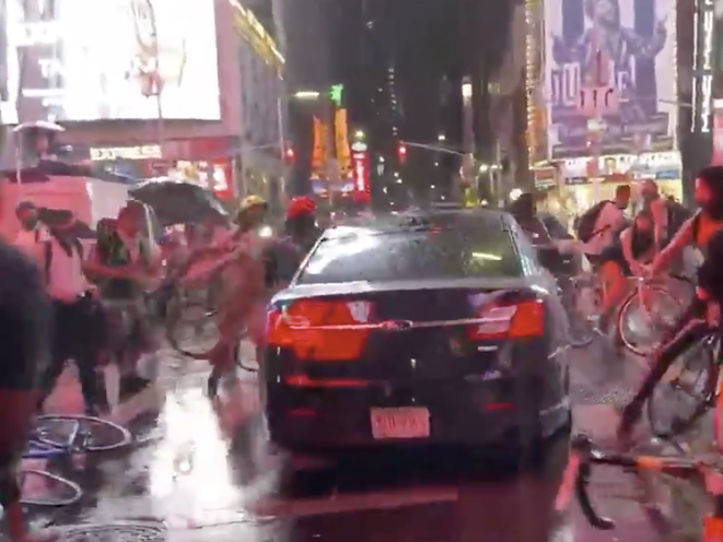 A vehicle seen driving through a crowd of protesters in Times Square on Thursday