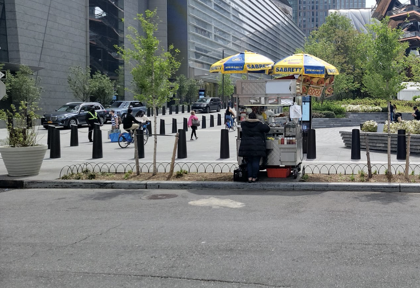 The smaller cart used by Awad, who alleges that Related has added new elements to the sidewalk to force him out
